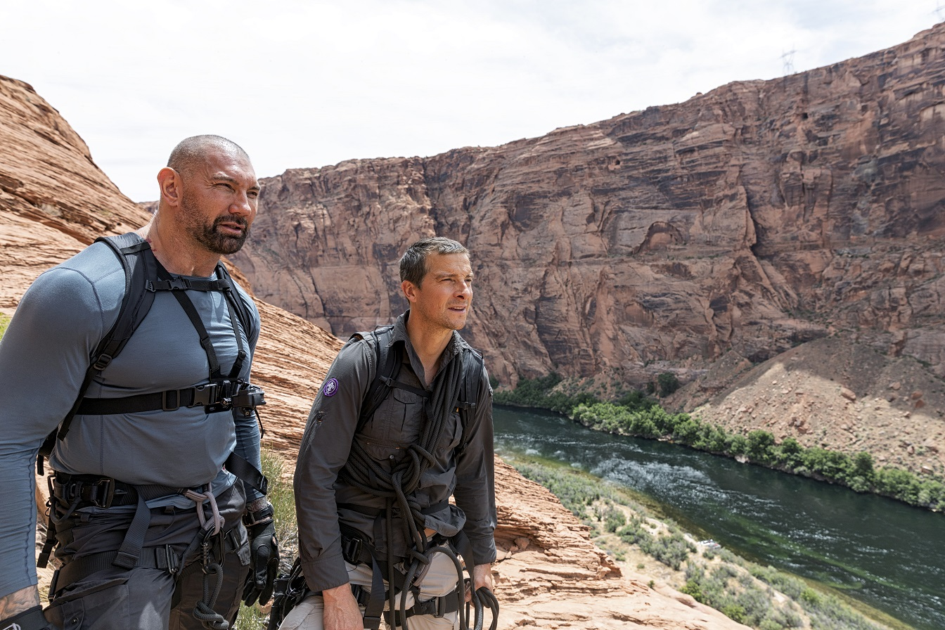 Horseshoe Bend, Ariz. - (L to R) Dave Bautista and Bear Grylls survey the Colorado River below for National Geographic's RUNNING WILD WITH BEAR GRYLLS. (National Geographic/Ben Simms)